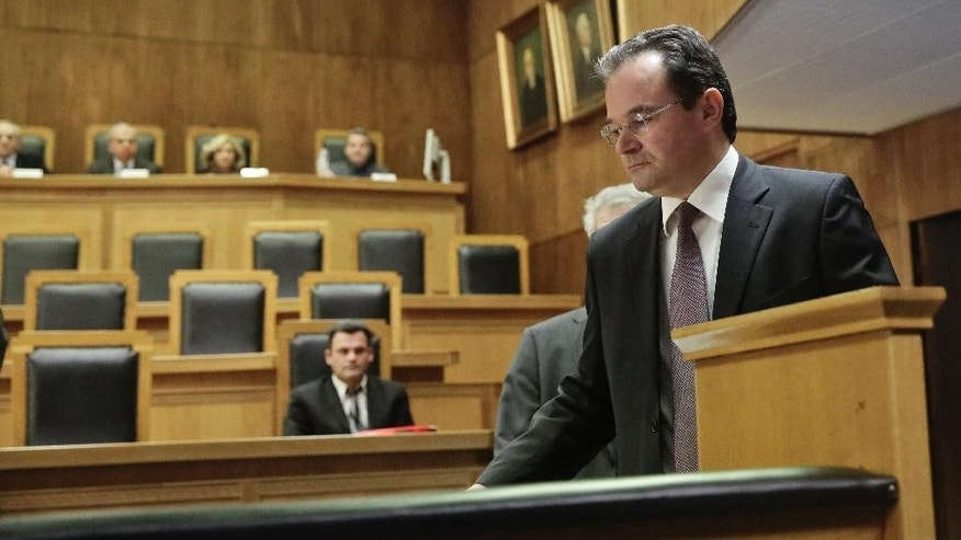 Former Greek finance minister George Papaconstantinou arrives  in court on Wednesday Feb. 25, 2015 at the start of a criminal trial against him on allegations he removed relatives' names from a list of Greeks holding Swiss bank accounts in HSBC. Papaconstantinou, 53, denies charges that he doctored the document, known in Greece as the Lagarde List, to remove three of his relatives. He was finance minister from late 2009 to mid 2011 and It was under him that Greece signed its first international bailout in May 2010. (AP Photo/Petros Giannakouris)