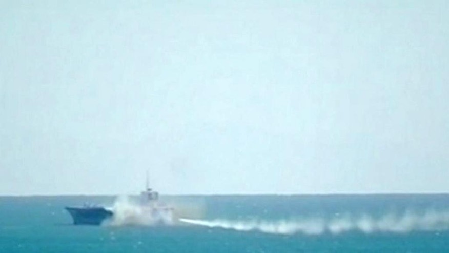 "This image taken from Iranian state television shows footage of a missile fired at a mock U.S. aircraft carrier during large-scale naval and air defense drills by Iran's Revolutionary Guard, near the Strait of Hormuz, Wednesday, Feb. 25, 2015. The drill, named Great Prophet 9, was the first to involve a replica of a U.S. carrier. Cmdr. Kevin Stephens, the spokesman for the U.S. Navy's 5th Fleet in Bahrain, said they were monitoring the drills, but downplayed the simulated attack on the carrier, saying the U.S. military was ""not concerned about this exercise.""(AP Photo/Iran state television via AP video)  TV OUT"