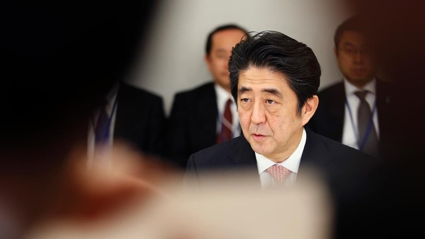 Japanese Prime Minister Shinzo Abe speaks at a meeting with a panel of experts at his official residence in Tokyo, Wednesday, Feb. 25, 2015. The panel of experts appointed by Abe met for the first time Wednesday to discuss what he should say in a statement marking the 70th anniversary of the end of World War II, fueling speculation that he may water down previous government apologies for the country's wartime past. (AP Photo/Shizuo Kambayashi)