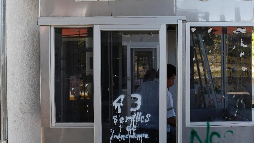 In this Jan. 28, 2015 photo, an operator works a toll booth on the outskirts of Chilpancingo, Mexico. In Guerrero and elsewhere, businesses complain they are losing merchandise to highway hijackings. Anti-government protesters have commandeered toll-booths, sacked government offices, blocked shipments and shut down airports. Drug cartels rule large swaths of land, extorting business owners, buying off authorities and disrupting important industries such as agriculture and tourism. (AP Photo/Dario Lopez-Mills)