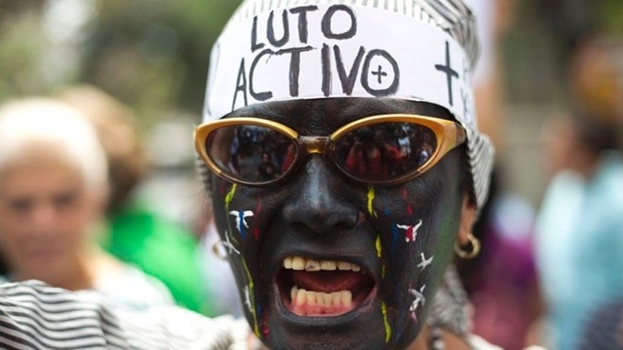 "A protester with her face painted and wearing the words ""In active mourning"" on Feb. 25, 2015."
