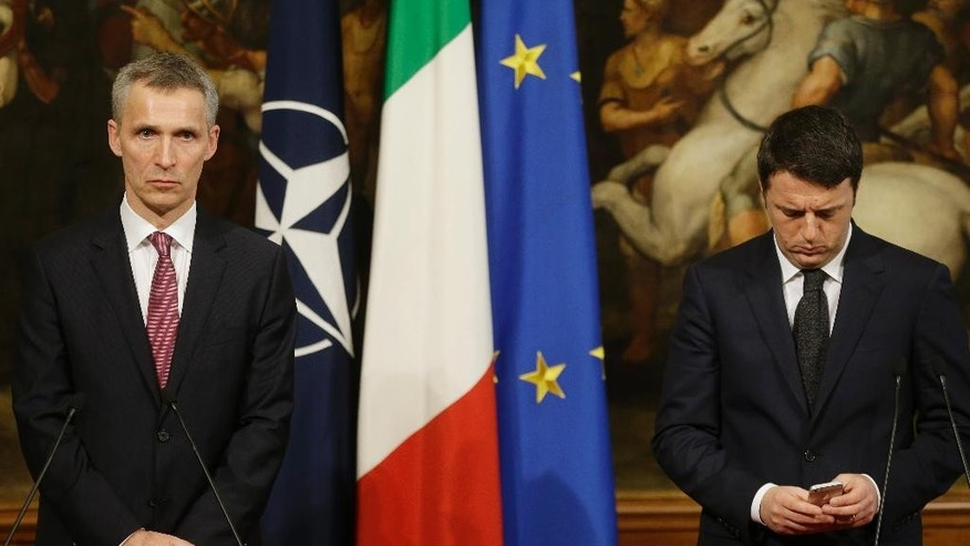 Italian Premier Matteo Renzi, right, and NATO Secretary General Jens Stoltenberg meet the journalists at the end of their meeting at Chigi palace premier's office, in Rome, Thursday, Feb. 26, 2015. (AP Photo/Gregorio Borgia)