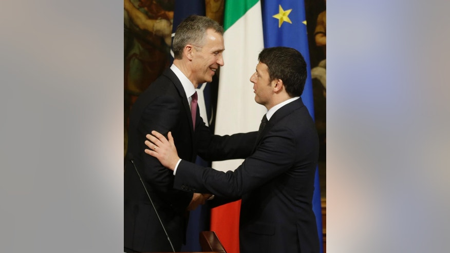 Italian Premier Matteo Renzi, right, greets  NATO Secretary General Jens Stoltenberg at the end of their meeting at Chigi palace premier's office, in Rome, Thursday, Feb. 26, 2015. (AP Photo/Gregorio Borgia)