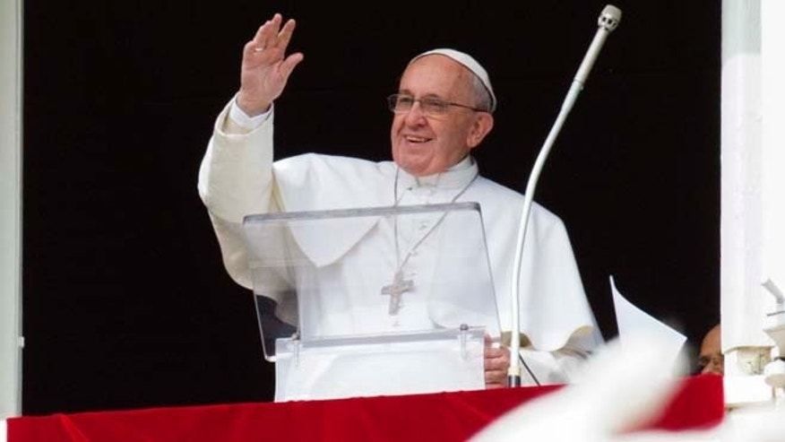 Feb. 22, 2015: Pope Francis waves to faithful from his studio window overlooking St. Peter's Square, during the Angelus noon prayer at the Vatican.
