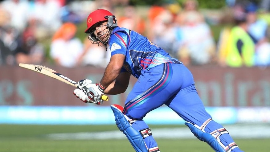 Afghanistan's Samiullah Shenwari bats during their Cricket World Cup Pool A match against Scotland in Dunedin, New Zealand, Thursday, Feb. 26, 2015. (AP Photo/Dianne Manson)
