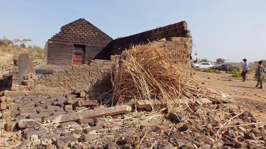 In this photo taken on Thursday, Feb. 19, 2015, a house allegedly destroyed by the Islamic extremist group Boko Haram near the village of Mabass, Cameroon. Cameroon officials say prisons are overcrowded with suspected Islamic extremists whose insurgency has spilled from Nigeria. (AP Photo/Edwin Kindzeka Moki)