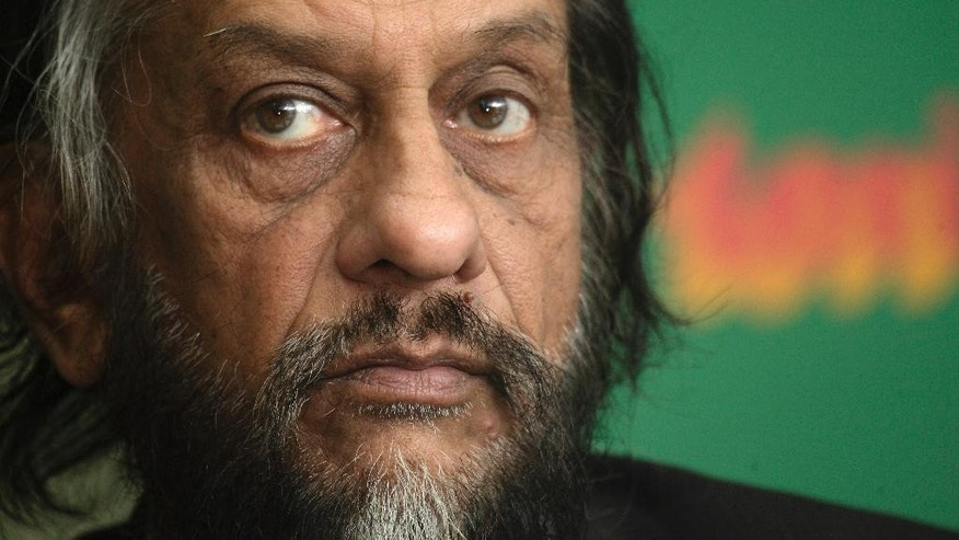 FILE- In this Jan. 21, 2010 file photo, the then head of U.N.'s Intergovernmental Panel on Climate Change (IPCC) Rajendra K. Pachauri looks on at a press conference in New Delhi, India. An Indian court has on Thursday, Feb.26, 2015 barred the former chairman of the U.N. climate panel from leaving India, where he faces sexual harassment charges.(AP Photo/Gurinder Osan, file)