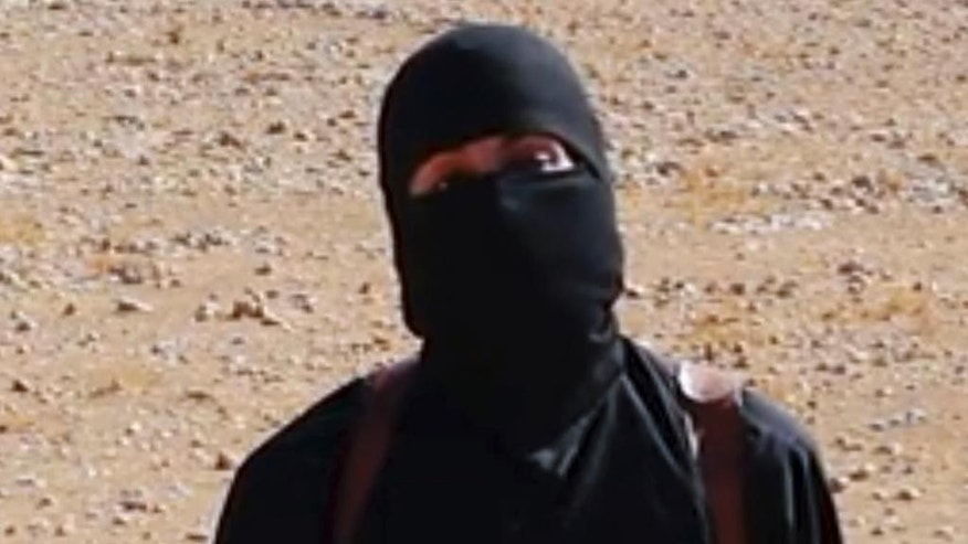 "FILE - This undated image shows a frame from a video released Friday, Oct. 3, 2014, by Islamic State militants that purports to show the militant who beheaded of taxi driver Alan Henning . A British-accented militant who has appeared in beheading videos released by the Islamic State group in Syria over the past few months bears ""striking similarities"" to a man who grew up in London, a Muslim lobbying group said Thursday Feb. 26, 2015. Mohammed Emwazi has been identified by news organizations as the masked militant more commonly known as ""Jihadi John."" London-based CAGE, which works with Muslims in conflict with British intelligence services, said Thursday its research director, Asim Qureshi, saw strong similarities, but because the hood worn by the militant, ""there was no way he could be 100 percent certain.""  (AP Photo)"