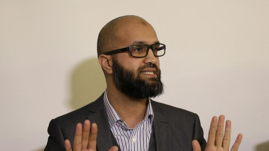 "CAGE research director, Asim Qureshi talks during a press conference held by the CAGE human rights charity in London, Thursday, Feb. 26, 2015. A British-accented militant who has appeared in beheading videos released by the Islamic State group in Syria bears ""striking similarities"" to a man who grew up in London, a Muslim lobbying group said Thursday. Mohammed Emwazi has been identified by news organizations as the masked militant more commonly known as ""Jihadi John."" London-based CAGE, which works with Muslims in conflict with British intelligence services, said Thursday its research director, Asim Qureshi, saw strong similarities, but because of the hood worn by the militant, ""there was no way he could be 100 percent certain."" (AP Photo/Matt Dunham)"