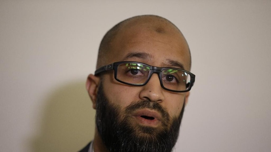 "CAGE research director, Asim Qureshi talks at a press conference held by the CAGE human rights charity in London, Thursday, Feb. 26, 2015. A British-accented militant who has appeared in beheading videos released by the Islamic State group in Syria bears ""striking similarities"" to a man who grew up in London, a Muslim lobbying group said Thursday. Mohammed Emwazi has been identified by news organizations as the masked militant more commonly known as ""Jihadi John."" London-based CAGE, which works with Muslims in conflict with British intelligence services, said Thursday its research director, Asim Qureshi, saw strong similarities, but because of the hood worn by the militant, ""there was no way he could be 100 percent certain."" (AP Photo/Matt Dunham)"