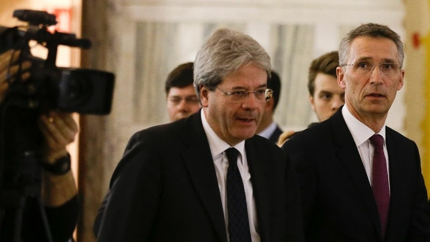 NATO Secretary General Jens Stoltenberg, right, and Italian Foreign Minister Paolo Gentiloni arrive for a joint press conference at the end of their meeting at the Foreign Ministry in Rome, Thursday, Feb. 26, 2015. (AP Photo/Gregorio Borgia)