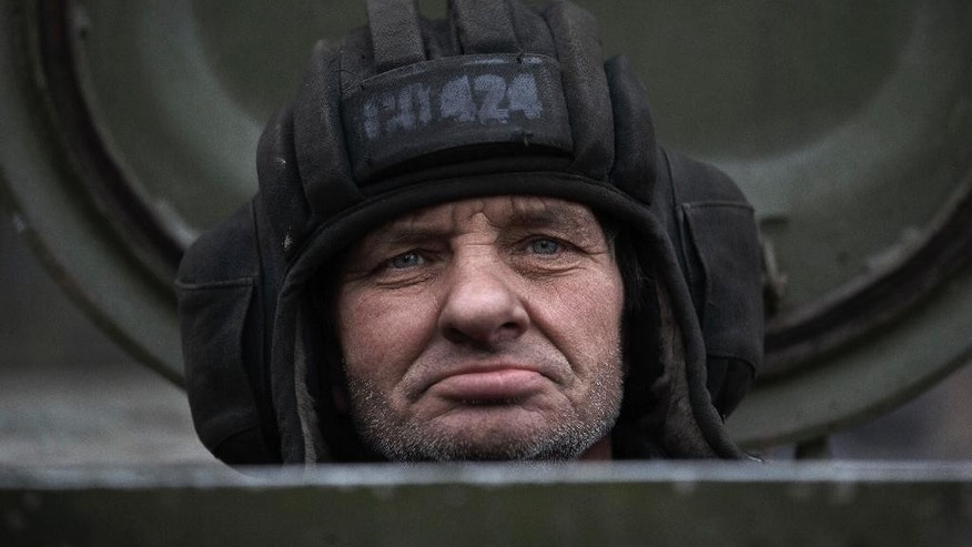 A Russia-backed separatist fighter sits in a self propelled 152 mm artillery piece, part of a unit moved away from the front lines, in Yelenovka, near Donetsk, Ukraine,Thursday, Feb. 26, 2015. Russia's foreign minister is sharply criticizing Ukraine's insistence that it won't begin pulling back heavy weapons in its fight against separatists in the east until the rebels fully observe a cease-fire. (AP Photo/Vadim Ghirda)