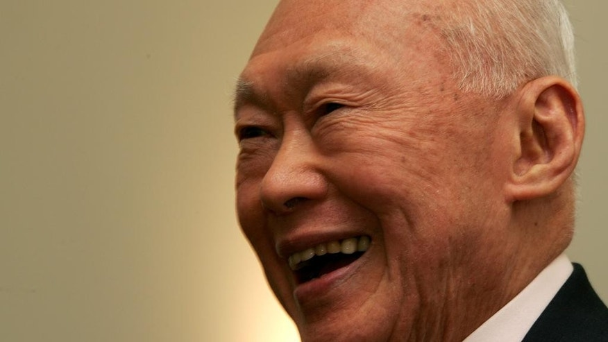 FILE - In this Oct. 17, 2005, file photo, former prime minister of Singapore, Lee Kuan Yew, reacts at the opening of the new Asia House in central London. Singapore's government said Thursday, Feb. 26, 2015, that Lee, the city-state's founding father, remains on life support in intensive care being treated for severe pneumonia. (AP Photo/Sergio Dionisio, File)