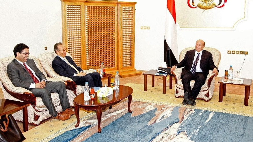 Yemen's embattled President Abed Rabbo Mansour Hadi, right, meets U.N. envoy to Yemen, Jamal Benomar, left, at the Republican Palace in the southern port city of Aden, Yemen, Thursday, Feb. 26, 2015. Aides to Yemen's embattled Hadi say he has met with the U.N. envoy to the country for the first time since fleeing the Shiite rebel-held capital. (AP Photo)