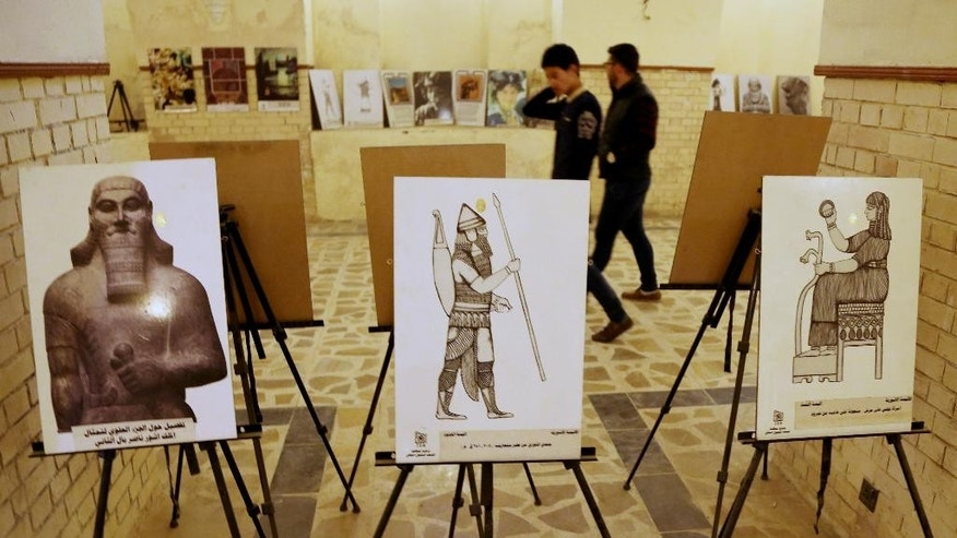 Iraqi artists held an exhibition on antiquities a day after Islamic State militants posted an online video showing them smashing rare ancient artifacts in a museum, in Baghdad, Iraq, Friday, Feb. 27, 2015. (AP Photo/Karim Kadim)