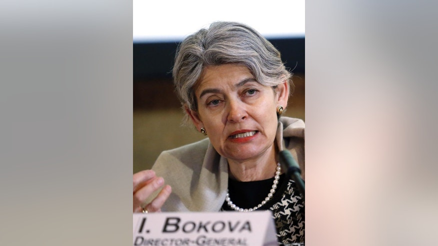 "Irina Bokova, Director General of the U.N.'s culture agency UNESCO, speaks during a press conference in Paris, France, Friday, Feb. 27, 2015. Bokova asked for an emergency meeting of the U.N. Security Council to be convened ""on the protection of Iraq's cultural heritage as an integral element for the country's security"" after extremists released a video thought to show men using sledgehammers to smash ancient Mesopotamian statues and other artifacts in Iraq's northern city of Mosul.(AP Photo/Jacques Brinon)"