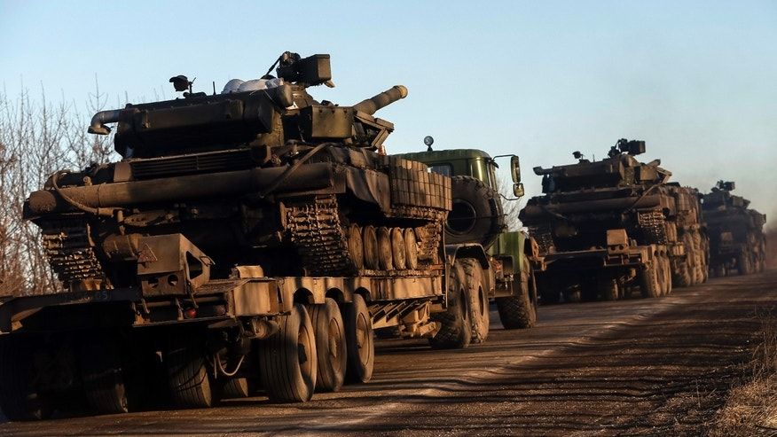 February 24, 2015 - Military trucks from the Ukrainian armed forces transport tanks on the road near Artemivsk, eastern Ukraine. Ukrainian and Russian-backed separatist forces drew back some heavy weapons from the front line in the east Friday in compliance with a cease-fire deal.