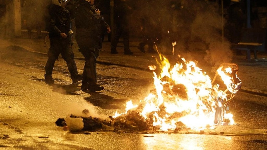 Riot police operate during clashes in the Athens neighborhood of Exarchia, a haven for extreme leftists and anarchists late Thursday, Feb. 26, 2015. The minor clashes broke out after an anti-government protest against Greece's four-month bailout extension agreement with European Union. (AP Photo)