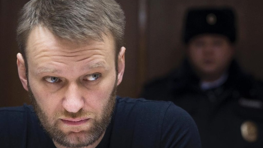 Russian opposition activist Alexei Navalny sits in a court room in Moscow, Russia, Friday, Feb. 27, 2015. Navalny was detained earlier this month for 15 days for distributing leaflets for an anti-government march, which he will miss if he remains in prison. (AP Photo/Pavel Golovkin)