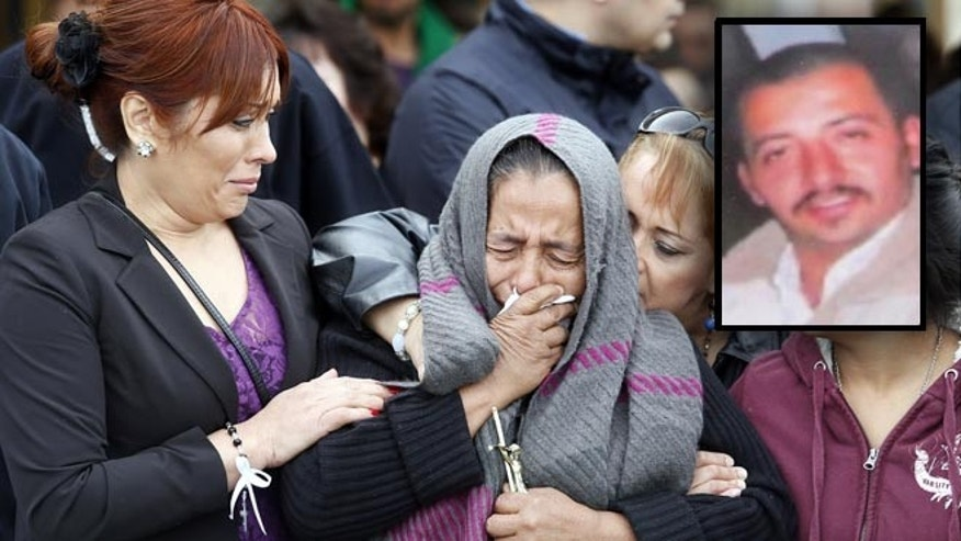 Agapita Montes-Rivera, second from left, the mother of Antonio Zambano-Montes, is comforted following the funeral for her son Wednesday, Feb. 25, 2015, at St. Patrick's Catholic Church in Pasco, Wash. Zambrano-Montes' Feb. 10 death in the agricultural city of Pasco has sparked protests and calls for a federal investigation. Police killed the unarmed man who spoke little English after he allegedly threw rocks at officers. (AP Photo/The Tri-City Herald, Andrew Jansen)