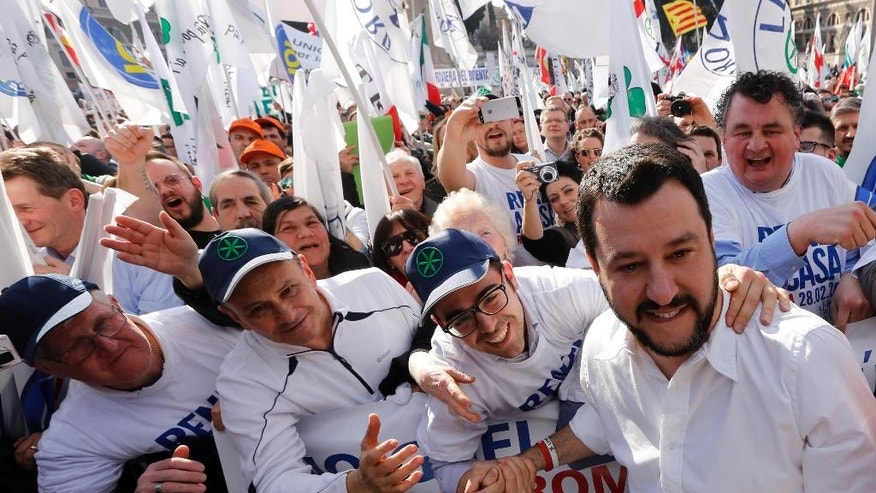 "Italian Lega Nord (Northern League) party Matteo Salvini, second right, poses for pictures with supporters during a protest to demand the Italian government keep out immigrants in Rome, Saturday, Feb. 28, 2015. Thousands of Northern League protesters have poured into Rome from their political base in the north to demand the Italian government keep out immigrants. Matteo Salvini's regional-based party drew 40,000 people a few months ago in Milan with the same agenda opposing immigration, which they blame for Italy's economic woes. Salvini said Premier Matteo Renzi's government is ""selling out to Europe."" (AP Photo/Riccardo De Luca)"