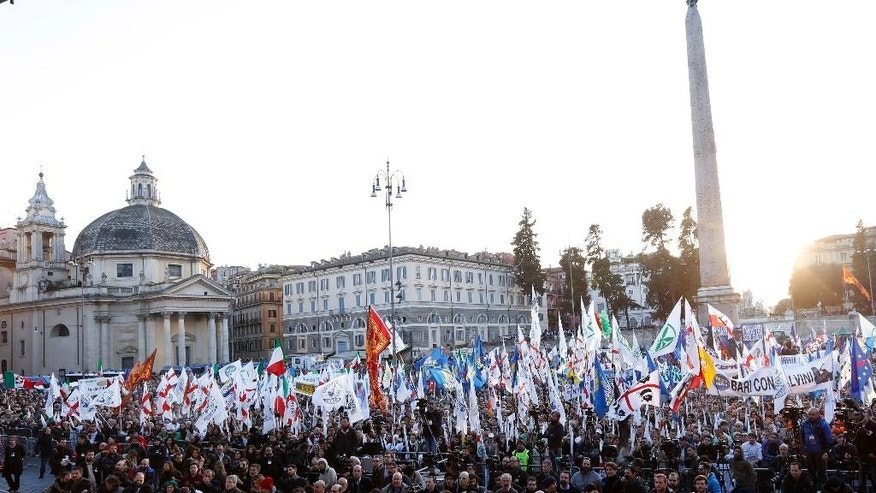"Italian Lega Nord (Northern League) protesters crowd Piazza del Popolo, a vast square in central Rome, during a rally to demand the Italian government keep out immigrants, Saturday, Feb. 28, 2015. Thousands of Northern League protesters have poured into Rome from their political base in the north to demand the Italian government keep out immigrants. Matteo Salvini's regional-based party drew 40,000 people a few months ago in Milan with the same agenda opposing immigration, which they blame for Italy's economic woes. Salvini said Premier Matteo Renzi's government is ""selling out to Europe."" (AP Photo/Riccardo De Luca)"