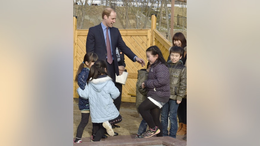 Britain's Prince William, left, chats with children as he visits Smile Kids Park playground in Motomiya city, in Japan's northeastern prefecture of Fukushima, Saturday, Feb. 28, 2015. Among the highlights of William's trip, through Sunday, is a visit to a school in the northeastern region of Fukushima, where some areas have been closed off around a nuclear power plant that went into multiple meltdowns four years ago.(AP Photo/Japan Pool) JAPAN OUT