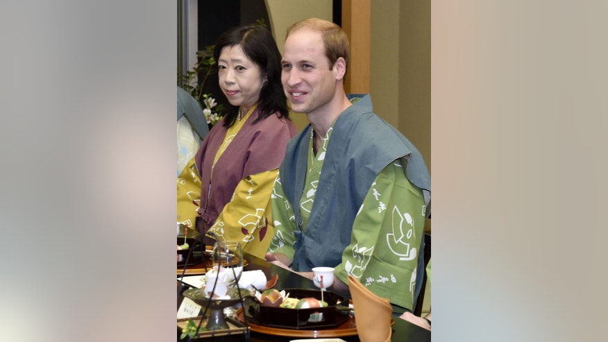 "Britain's Prince William, right, smiles wearing ""yukata,"" or kimono-style pajamas, during a dinner with Japanese Prime Minister Shinzo Abe in Koriyama,  Japan's northeastern prefecture of Fukushima, Saturday, Feb. 28, 2015. (AP Photo/Japan Pool) JAPAN OUT"