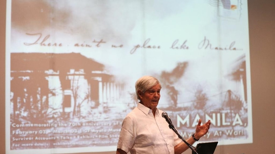 In this Feb. 3, 2015 photo, British Roderick Hall speaks during a commemorative event for the 70th year of the Battle for Manila at the Ayala Museum in suburban Makati, south of Manila, Philippines. Hall was 9 when the Japanese occupied Manila. In late January 1945, before American forces closed in on the capital, the Japanese barged into the family home, searched every room and found what the raiders claimed was an illegal radio transmitter. Hall, now a business investor, said it was just a short-wave radio the family listened to for news outside Manila. (AP Photo/Aaron Favila)
