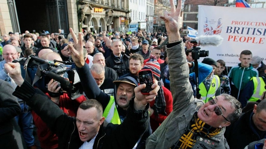 Protesters march during the first rally in Britain from the anti-Islam group Pegida in Newcastle city center, Saturday Feb. 28, 2015. (AP Photo/PA, Richard Sellers) UNITED KINGDOM OUT  NO SALES  NO ARCHIVE