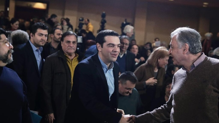 Greek Prime Minister and Syriza leader Alexis Tsipras, centre, arrives at his party central committee, in Athens, on Saturday, Feb. 28, 2015. Greece's new radical left government has no intention of seeking yet another bailout deal from international creditors and will spend coming months trying to ease the terms of its current commitments, the financially struggling country's prime minister said Friday.(AP Photo/Petros Giannakouris)