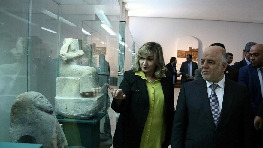 Iraq's Prime Minister Haider al-Abadi visits the Iraqi National Museum in Baghdad, Iraq, Saturday, Feb. 28, 2015. Al-Abadi vowed to track down and punish those who were behind the smashing of rare ancient artifacts in the northern Iraqi city of Mosul. On Thursday, the Islamic State group released a video purportedly showing militants using sledgehammers to smash the statues, describing them as idols that must be removed. The act brought global condemnation. (AP Photo)