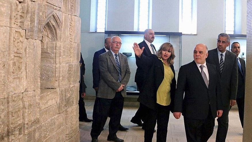 Iraq's Prime Minister Haider al-Abadi, third right, tours the Iraqi National Museum in Baghdad, Iraq, Saturday, Feb. 28, 2015. Al-Abadi vowed to track down and punish those who were behind the smashing of rare ancient artifacts in the northern city of Mosul. On Thursday, the Islamic State group released a video purportedly showing militants using sledgehammers to smash the statues, describing them as idols that must be removed. The act brought global condemnation. (AP Photo)