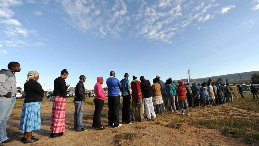 Voters queue to cast their votes in Maseru, Lesotho, Saturday, Feb 28, 2015. The small mountain kingdom goes to the polls in early elections in the hope of restoring order after a coup attempt last year, but there is concern that a rejection of the results by some parties could spark more violence, jeopardizing hopes of improvement for the country's poor majority. (AP Photo)