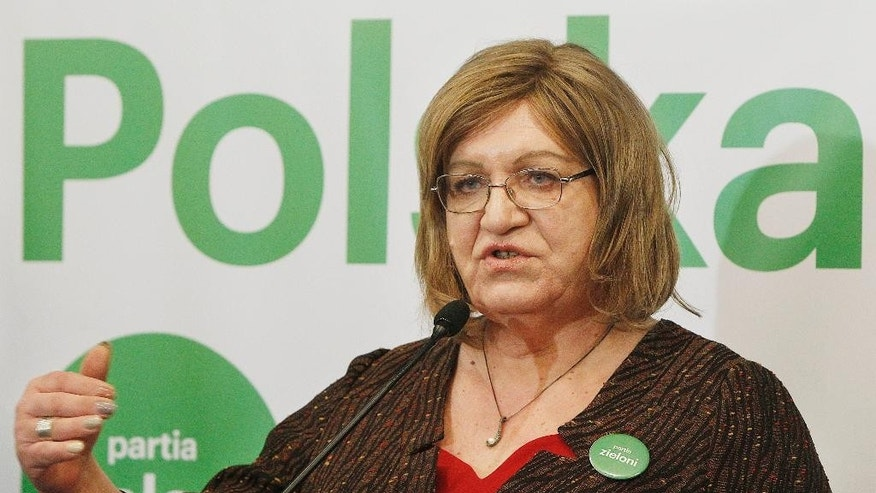 "In this file photo from Feb. 13, 2015, Anna Grodzka, Poland's only transsexual lawmaker, launches a campaign to run for president as the candidate for the Green party. Behind her is her campaign slogan written large: ""Polska Fair,"" or ""A Fair Poland."" Grodzka is one of four left-wing candidates running for the presidency in May elections, one sign of a fragmented and weak left wing. In a struggle to reverse declining fortunes, the country's main left-wing party, the Democratic Left Alliance, picked a presidential candidate with striking good looks but no political experience, a move that even the party faithful are ridiculing. (AP Photo/Czarek Sokolowski)"