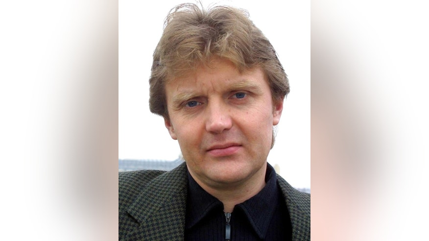 "FILE - In this Friday May 10, 2002 file photo Alexander Litvinenko, former KGB spy and author of the book ""Blowing Up Russia: Terror From Within"", is photographed at his home in London. Prominent Russian opposition figure Boris Nemtsov's killing follows the slaying over the past decade of several other high-profile critics of President Vladimir Putin and his policies. Former Russian intelligence officer Alexander Litvinenko, 44, became sick after drinking tea laced with radioactive polonium-210 at a London hotel in November 2006 and died three weeks later. Litvinenko had fallen out with the Russian government and became a strong critic of the Kremlin, obtaining political asylum after coming to Britain in 2000. (AP Photo/Alistair Fuller, File)"