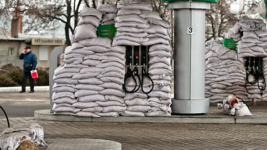 Fuel pumps are covered in sandbags in order to be protect them from possible shelling in Donetsk, Ukraine, Saturday, Feb. 28, 2015.  The recent pullback of some weapons from the line separating government and rebel forces in Ukraine seems to have boosted the prospects for peace, although both sides are warning of their readiness to resume fighting if necessary. (AP Photo/Vadim Ghirda)