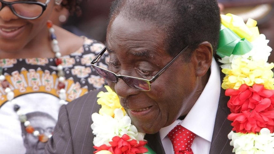 Zimbabwe President Mugabe smiles during celebrations to mark his 91st birthday in the resort town of Victoria Falls, Zimbabwe, Saturday Feb, 28, 2015. Mugabe turned 91 on the 21st of February to become the worlds oldest leader with his supporters saying they will back him to run his full term until 2018 and beyond despite nagging questions about his health and a struggling economy.(AP Photo/Tsvangirayi Mukwazhi)