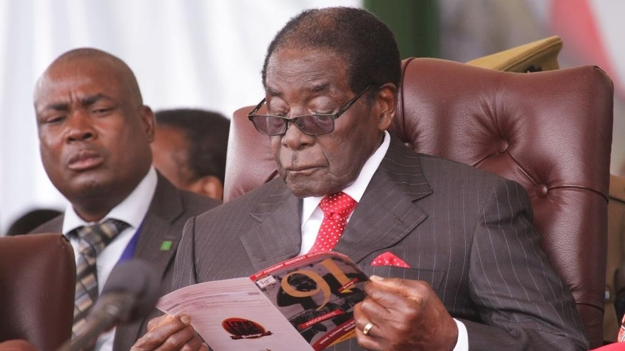 Zimbabwe President Mugabe is seen during celebrations to mark his 91st birthday in the resort town of Victoria Falls, Zimbabwe, Saturday Feb, 28, 2015. Mugabe turned 91 on the 21st of February to become the worlds oldest leader with his supporters saying they will back him to run his full term until 2018 and beyond despite nagging questions about his health and a struggling economy.(AP Photo/Tsvangirayi Mukwazhi)