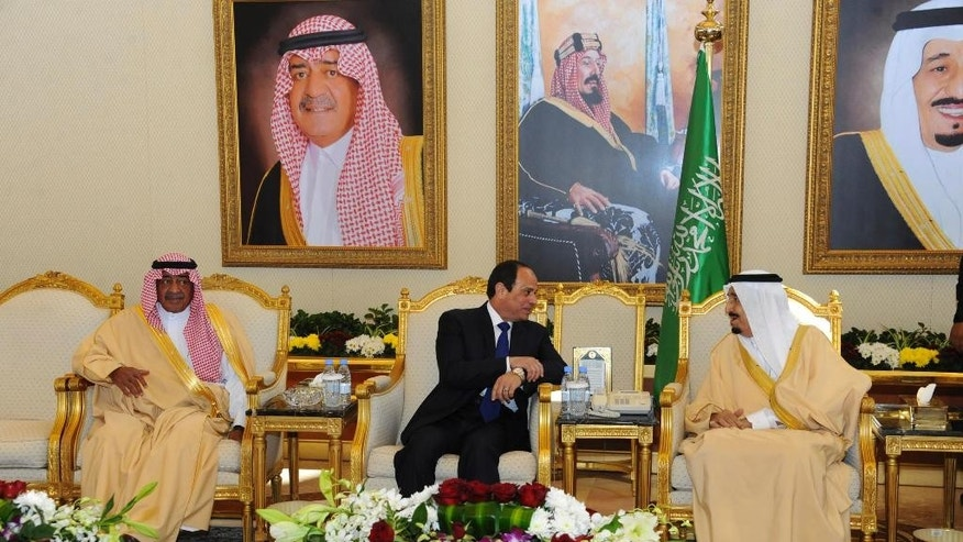 "In this image released by the Egyptian Presidency, Egyptian President Abdel-Fattah el-Sissi, center, meets with Saudi King Salman, right, and Crown Prince Muqrin bin Abdul-Aziz, in Riyadh, Saudi Arabia, Sunday, March 1, 2015. El-Sissi arrived Sunday for his first bilateral policy meeting with the new king ahead of a conference aimed at shoring up financial support from wealthy Gulf states for Egypt's battered economy. It marks the first meeting for the two since audio was leaked in February of el-Sissi allegedly poking fun at the Gulf's immense oil wealth and saying ""money there is like rice. (AP Photo/Egyptian Presidency)"