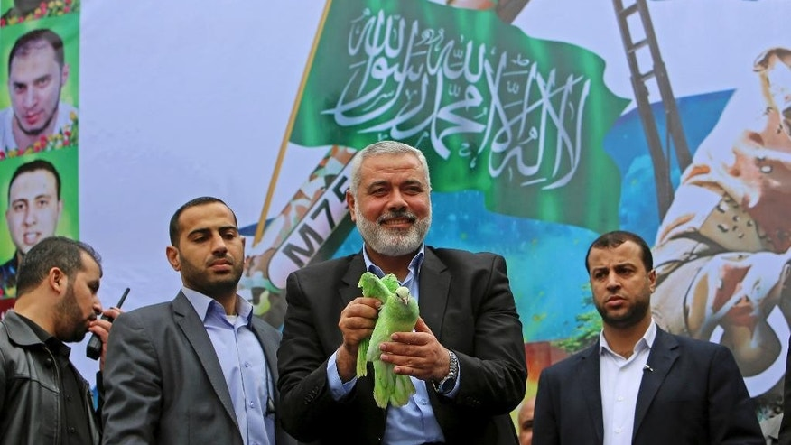 Dec. 12, 2014: Top Palestinian Hamas leader Ismail Haniyeh holds a dove sprayed green, the color of Hamas, before he releases it during a rally to commemorate the 27th anniversary of the Hamas militant group, at the main road in Jebaliya, the northern Gaza Strip. (AP)