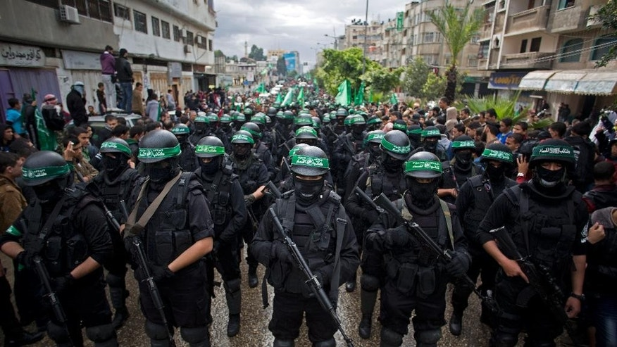 Dec. 14, 2014: Masked Palestinian Hamas gunmen display their military skills during a rally to commemorate the 27th anniversary of the Hamas militant group, in Gaza City, Gaza. (AP)