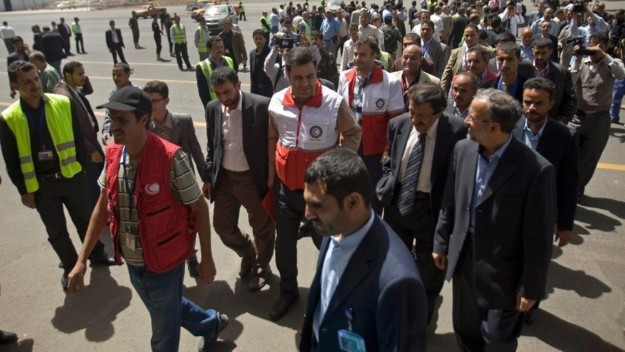 Aid workers from the Iranian Red Crescent and other passengers arrive to the international airport of Sanaa, Yemen, Sunday, March 01, 2015. The first direct flight from Iran to the rebel-held Yemeni capital arrived Sunday as the country's Shiite rebels formalize ties with the regional Shiite powerhouse. (AP Photo/Hani Mohammed)