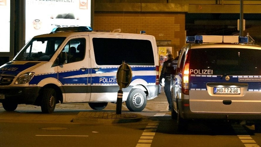 In this Saturday Feb. 28, 2015 picture,  police vehicles block the road during a  search operation at an Islamic culture center  in Bremen, Germany, Police in the German city of Bremen warned Saturday of a potential danger from Islamic extremists there and stepped up security measures. Police said they stepped up their presence in the city and, as a precaution, increased security for the Jewish community. They said Saturday evening, several hours after issuing the warning, that they had carried out searches on an unidentified suspect and at an Islamic culture center. One person was arrested, they added.  (AP Photo/dpa, Carmen Jaspersen)