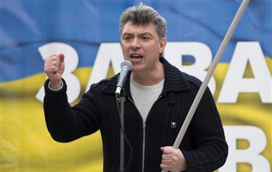 In this photo taken on Saturday, March  15, 2014, Boris Nemtsov, a former Russian deputy prime minister and opposition leader addresses demonstrators during a massive rally to oppose president Vladimir Putin's policies in Ukraine, in Moscow, Russia.  Nemtsov was gunned down Saturday near the Kremlin, just a day before a planned protest against the government.  (AP Photo/Alexander Zemlianichenko)