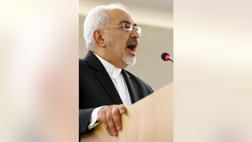 Iranian Foreign Minister Mohammad Javad Zarif  delivers a speech  during the  28.  session of the Human Rights Council, at the European headquarters of the United Nations, in Geneva, Switzerland, Monday, March 2, 2015.  (AP Photo/Keystone,Salvatore Di Nolfi)