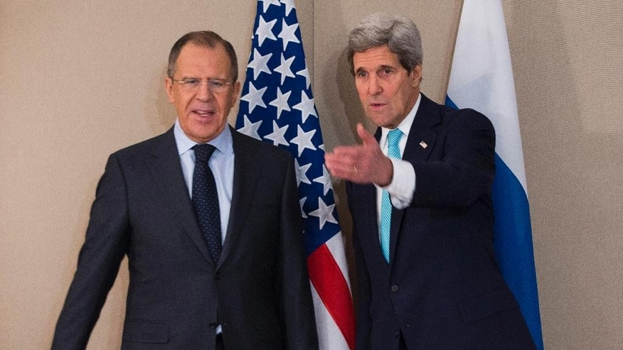 U.S. Secretary of State John Kerry, right, meets with Russian Foreign Minister Sergey Lavrov Monday, March 2, 2015 in Geneva. The meeting came amid continuing tensions over Ukraine and American calls for a full probe into the murder of a prominent opposition figure in Moscow. (AP Photo/Evan Vucci, Pool