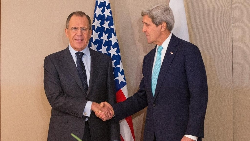 U.S. Secretary of State John Kerry, right, meets with Russian Foreign Minister Sergey Lavrov Monday, March 2, 2015 in Geneva. The meeting came amid continuing tensions over Ukraine and American calls for a full probe into the murder of a prominent opposition figure in Moscow. (AP Photo/Evan Vucci, Pool)