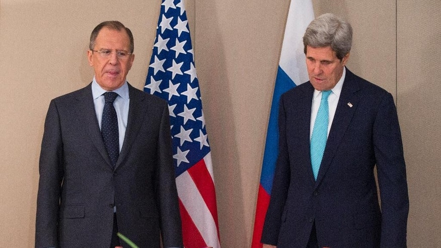U.S. Secretary of State John Kerry, right, stands with Russian Foreign Minister Sergey Lavrov Monday, March 2, 2015 in Geneva. The meeting came amid continuing tensions over Ukraine and American calls for a full probe into the murder of a prominent opposition figure in Moscow. (AP Photo/Evan Vucci, Pool)