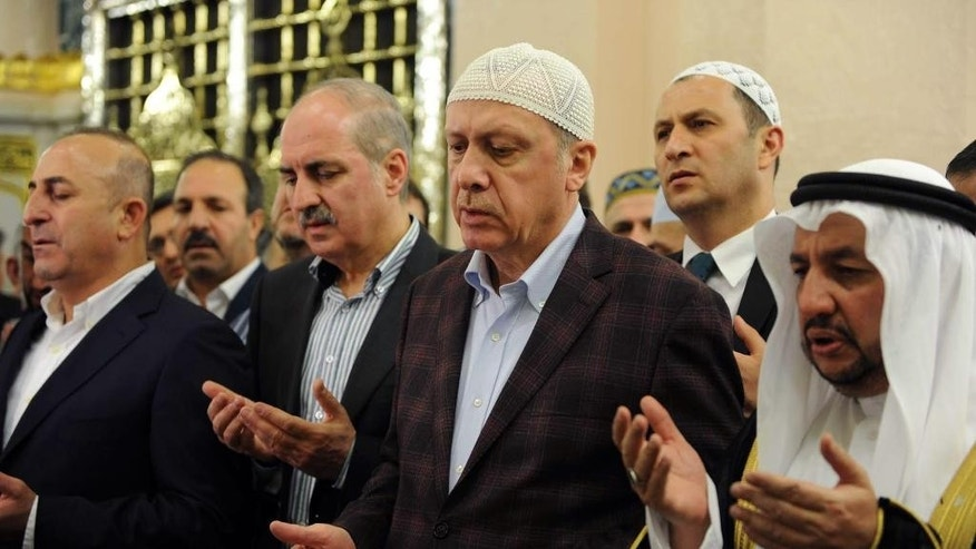 In this photo provided by the Saudi Press Agency, Turkey's President Recep Tayyip Erdogan, third right, prays at the Prophet Mohammed Mosque, the second holiest site in Islam, in the Saudi holy city of Medina, Monday, March 2, 2015. Saudi King Salman is scheduled to meet Monday with Erdogan. (AP Photo/SPA)